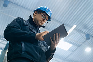 warehouse worker using a tablet
