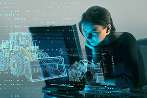 Woman on computer with wireframe graphics