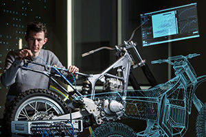 Man working on motorcycle with wireframe showing