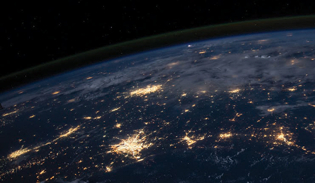 Earth from outer space with city lights visible