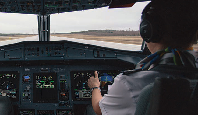 Pilot taking off in aircraft