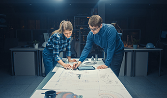 Man and woman discussing product drawing