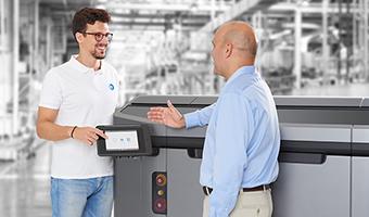 Two men discussing 3D printing